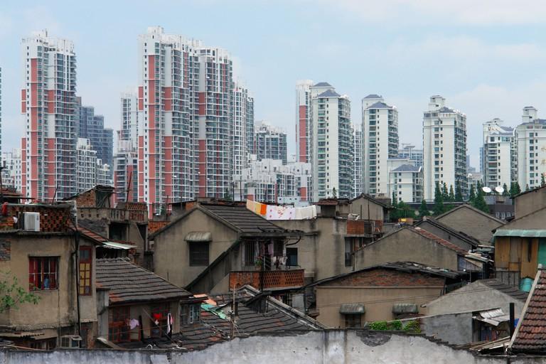 Old buildings against modern skyscrapers in Shanghai