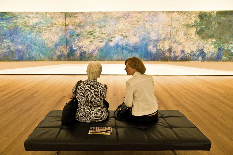 "In front of Monet's ""Water Lillies"" at MOMA, New York City."