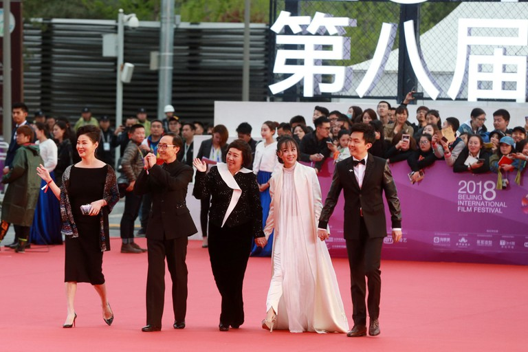 Celebrities shine at the red carpet for Beijing International Film Festival closing ceremony.