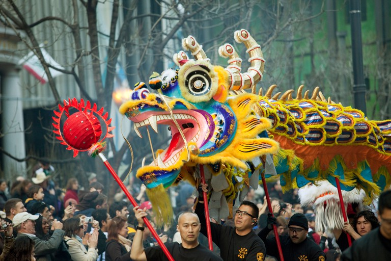 Dragon is carried down Market Street during Chinese New Year parade, San Francisco