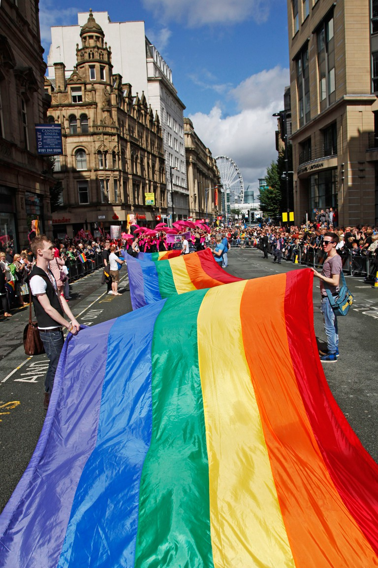 Giant rainbow flag at Manchester Gay Pride Parade, Manchester, England.