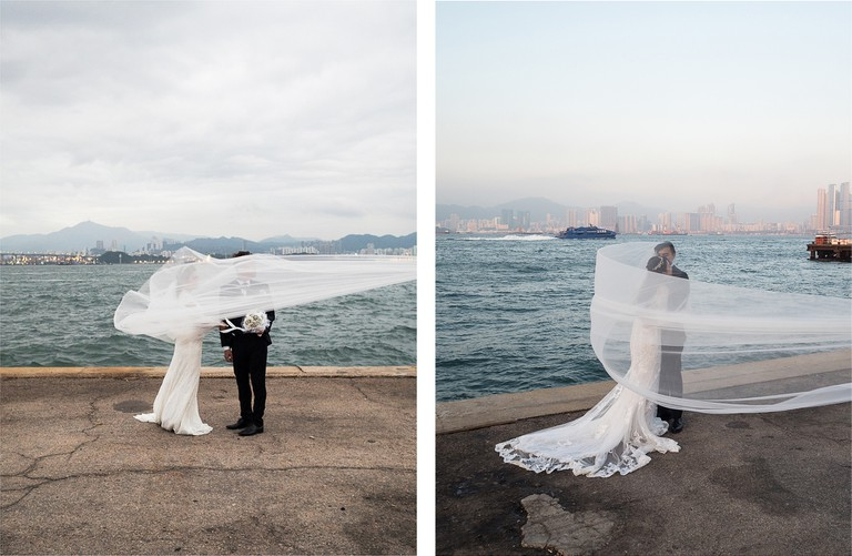"A couple posing for wedding photos on the ""Instagram Pier"", Hong Kong"