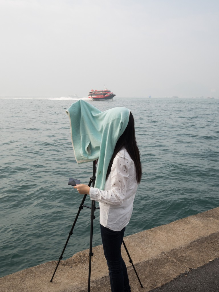 "A photographer on the ""Instagram Pier"", Hong Kong"