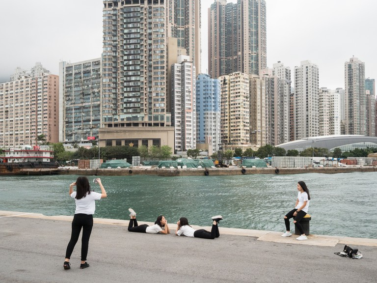 "A group of young girls photographing themselves at the ""Instagram Pier"", Hong Kong"