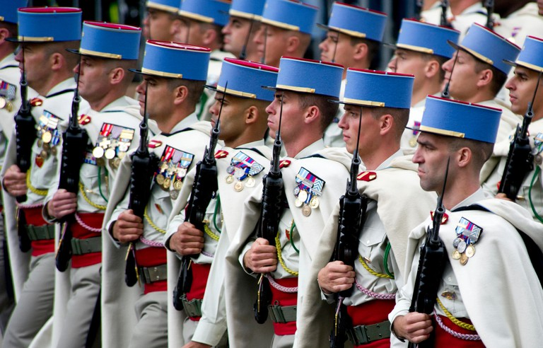 Soldiers from France's Spahis Regiment march down Avenue des Champs-Elysees during Bastille Day, Paris