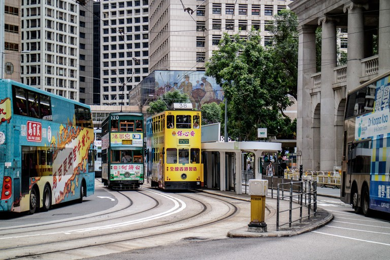 Ding Ding, Colorful, iconic double-decker trams of Hong Kong at Bank Street stop