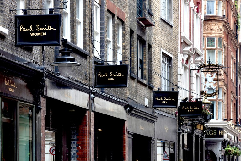 Paul Smith Shop signs line Floral Street in Covent Garden, London