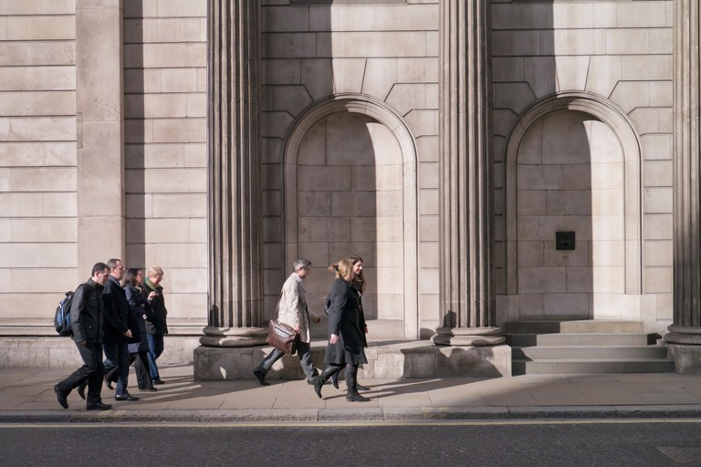 City workers walking up Threadneedle Street past the Bank of England: London.