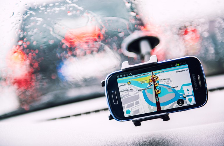Smart phone with a Waze GPS navigator on the screen
