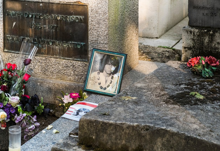 Graveside of Jim Morrison, at Pere Lachaise cemetery in Paris, France.