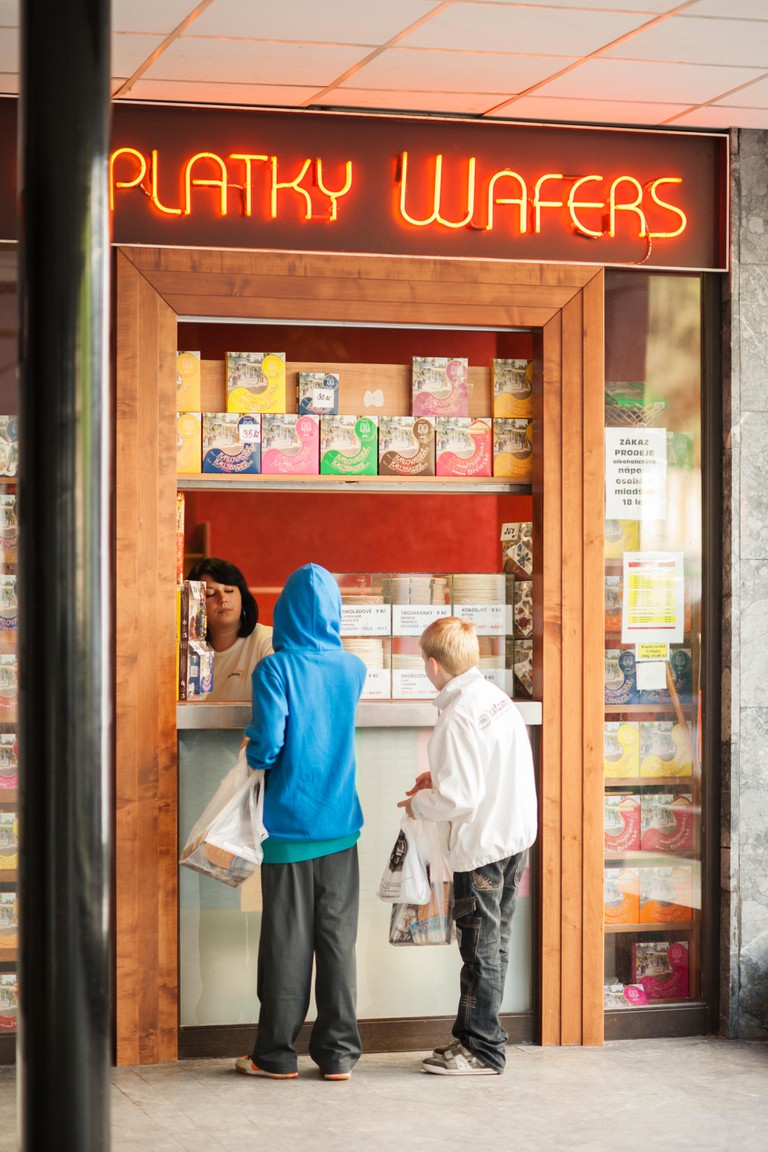 Young customers purchasing the age old traditional famous wafer snack in this mineral spa town, Karlovy Vary (Karlsbad), Czech