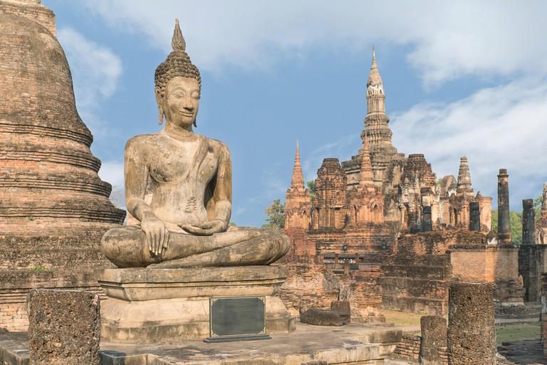 Buddha Statue at Wat Mahathat in Sukhothai Historical Park, Sukhothai, Thailand.