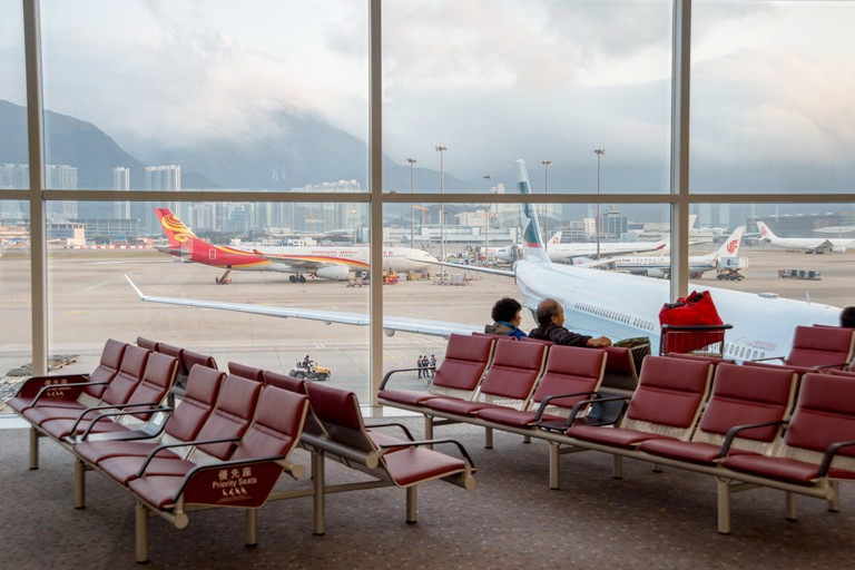 Passengers waiting for their flights at Hong-Kong Airport