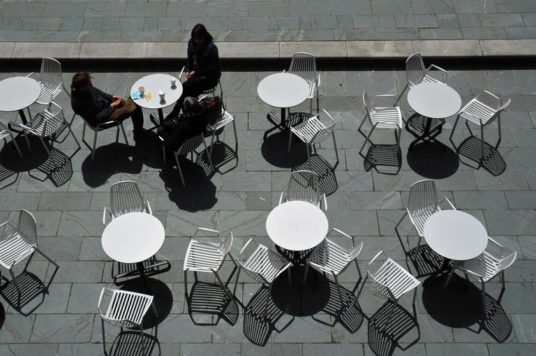 Tables and chairs near Oxo Building, South Bank, London, England, UK