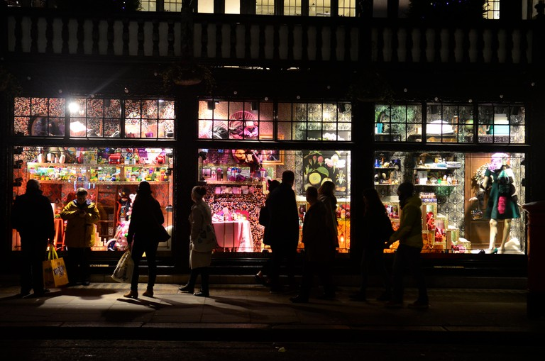 People looking into the window and Christmas decorations at Liberty store, Great Marlborough Street, London, 2015