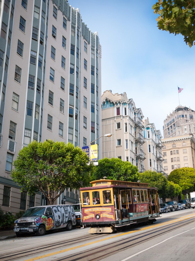 A view of the California Street cable car moving down Nob Hill, San Francisco.
