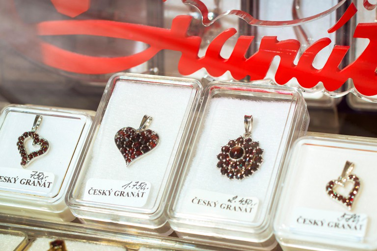 KUTNA HORA, CZECH REPUBLIC - AUGUST 26, 2015: Jewellery from Bohemian garnets in the tourist shop, Kutna Hora, Czech Republic