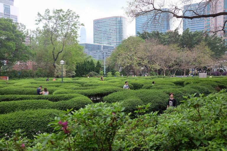 Visitors walk through the maze in Kowloon Park, Hong Kong