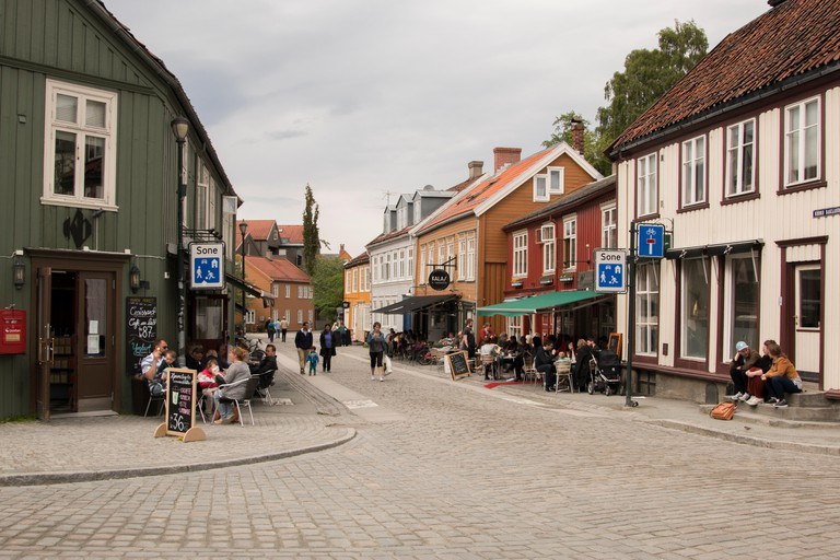 People on the streets of Bakklandet in Trondheim, Norway.