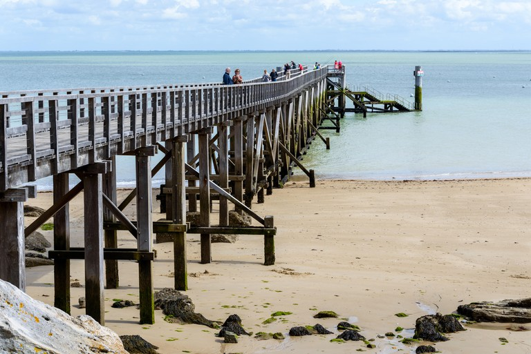 Pier on Plage des Dames on the island of Noirmoutier, France.