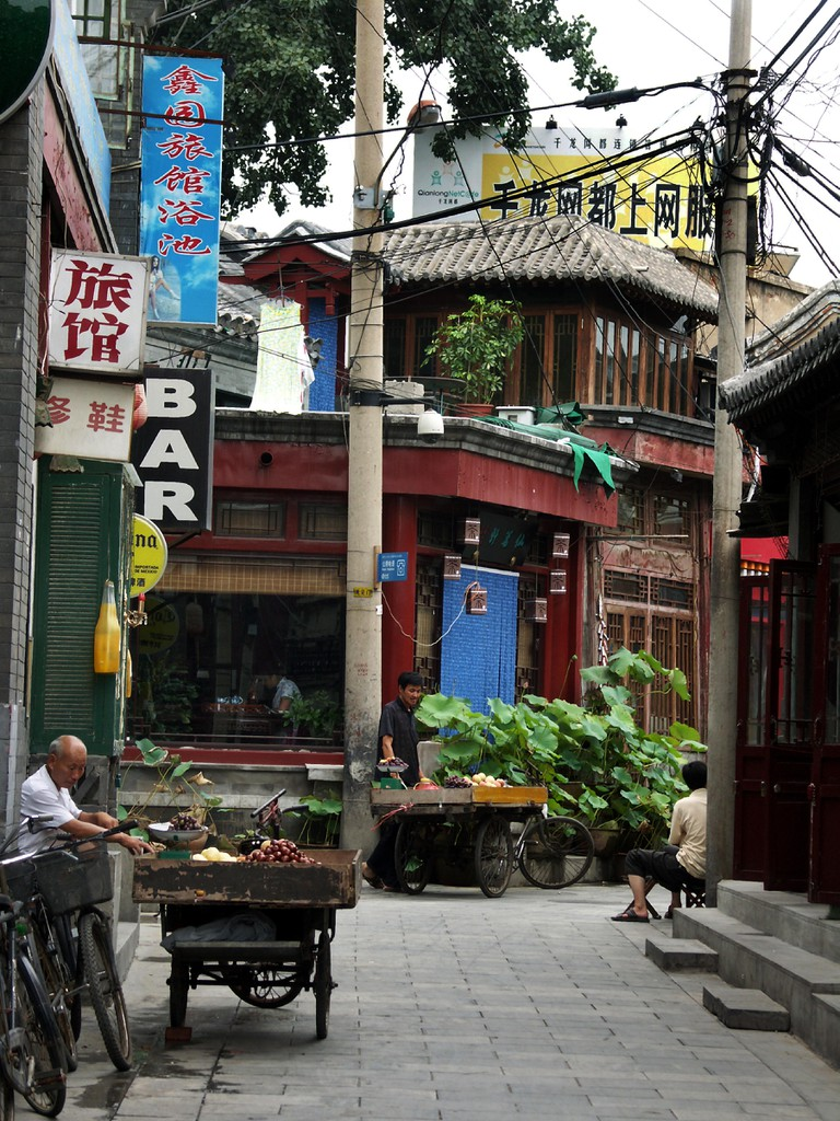 Cafes and shops in a hutong neighborhood. Beijing. China. Image shot 2004. Exact date unknown.