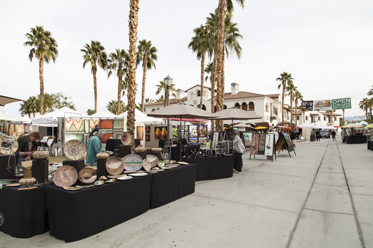 Travelers should experience the La Quinta Arts Festival in Old Town La Quinta
