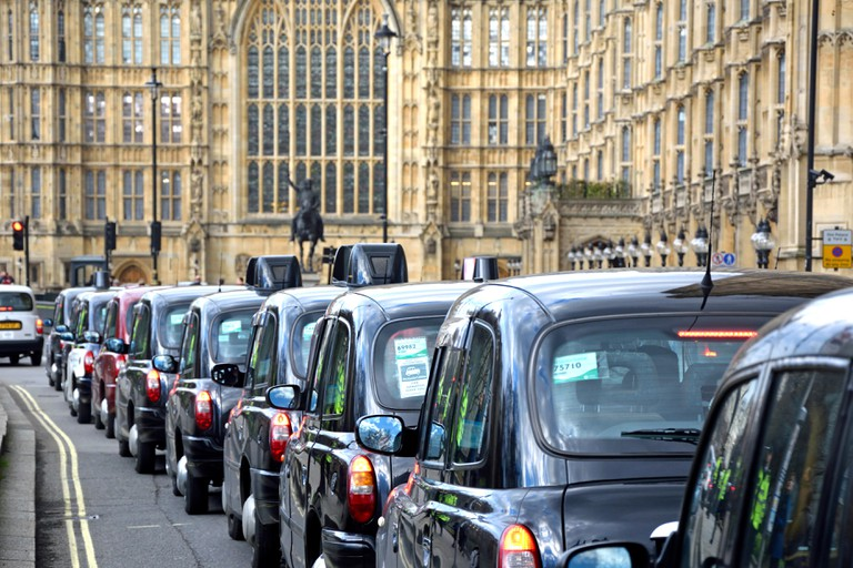 London, England, UK. A long queue of taxis outside Parliament during a protest against Uber, Feb 2016