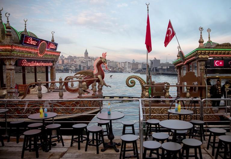 Gaudy Balik Ekmek ('Fish in Bread') boats await customers at Eminonu, Istanbul