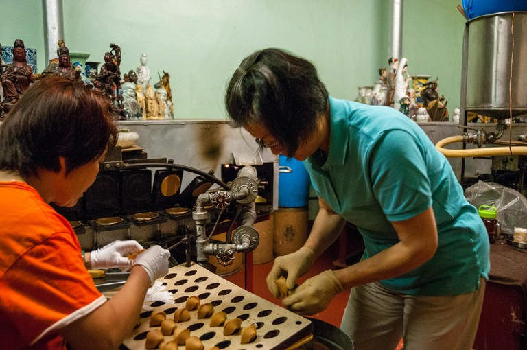 Making fortune cookies at the Golden Gate Fortune Cookie Factory, Chinatown, San Francisco
