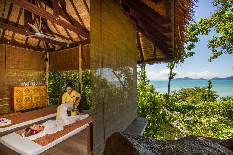 A woman enjoys a seaside massage at Kamalaya Wellness Sanctuary and Holistic Spa