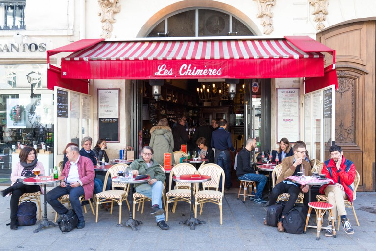 The cafe Les Chimeres situated in a busy corner of the place de Saint Paul in Paris