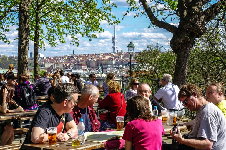 People at a beer garden in Prague, Czech Republic.