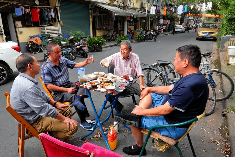 Friends toast during an outdoor lunch, Shanghai