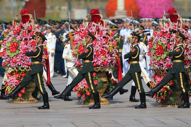 Chinese People's Liberation Army Honor Guards Guard During a Flower Laying Ceremony a Day Before the National Day at the Monument to the People's Heroes at Tiananmen Square during the Golden Week.
