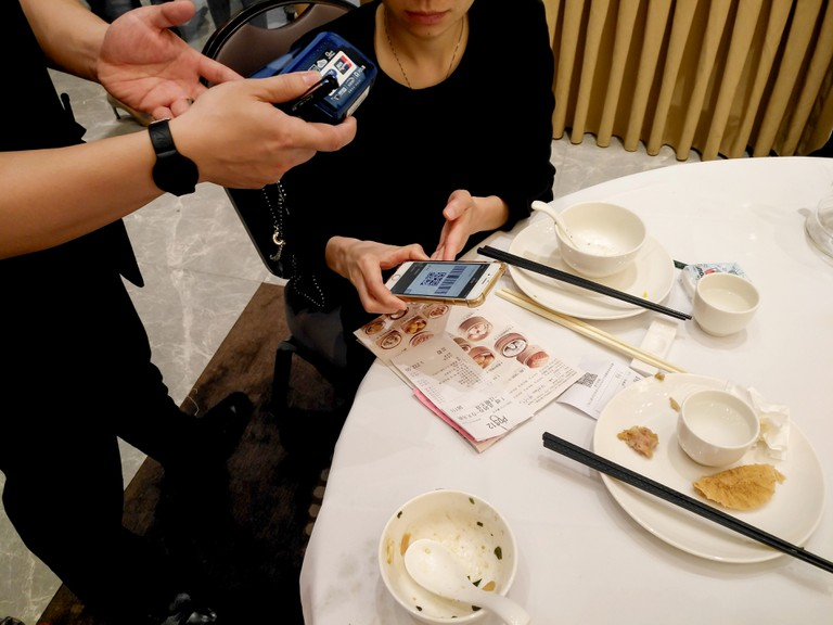 Zhongshan,China-May 13, 2018:doing payment at a restaurant via Wechat money on mobile.Wechat or Alipay for payment and money transfering via mobile be
