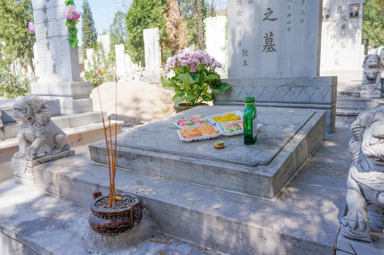 Chinese people go to cemetery to commemorate their relatives in Qingming Festival. Qingming Festival -- means clear and bright in Chinese, also known as the Tomb Sweeping Festival, is the day for mourning the dead.