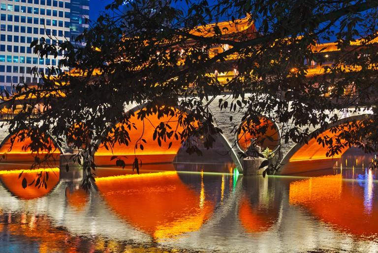 Night view of Anshun Bridge with reflection in Jin River, Chengdu, Sichuan Province, China