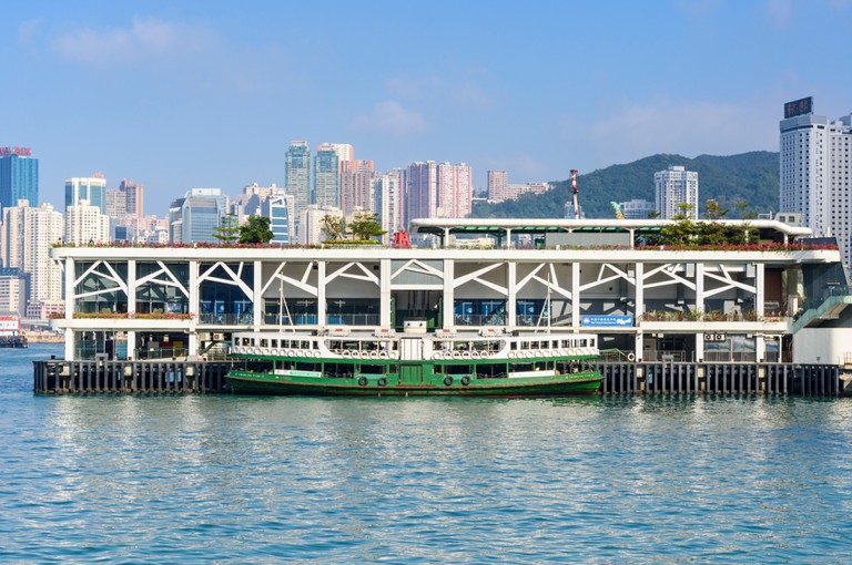 A Star Ferry moored at the Wan Chai Ferry Pier, Wan Chai, Hong Kong.