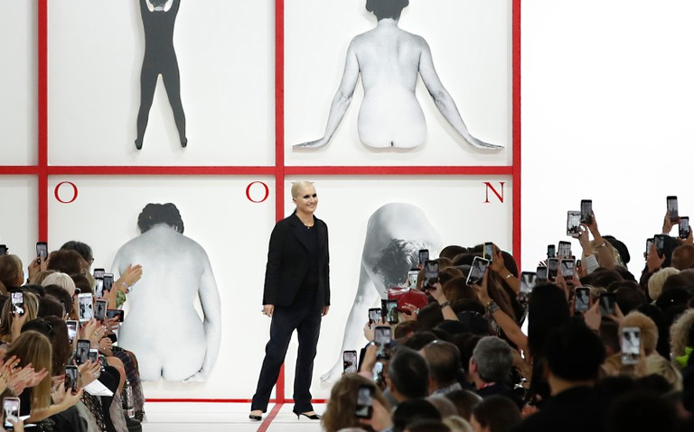 Designer Maria Grazia Chiuri accepts applause at the end of the Dior ready to wear Fall-Winter 2019-2020 collection.