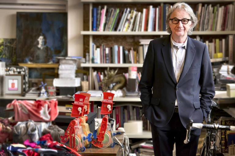 Sir Paul Smith stands in his office in Covent Garden, London