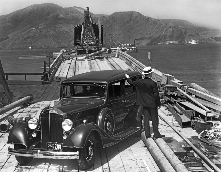A man with a 1933 Packard on the trestle to the South Tower during the beginning of the construction of the Golden Gate Bridge, San Francisco, California, USA.