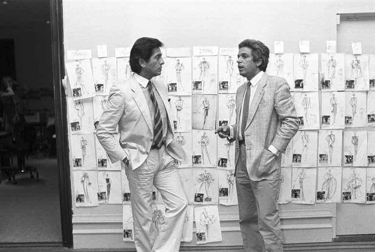 Valentino and Giammetti working on plans for the show in their atelier work room, New York