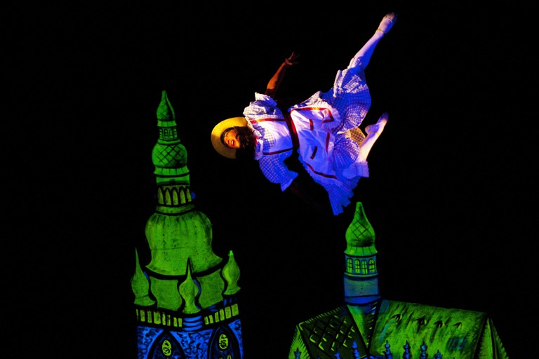 A scene from 'Aspects of Alicia' at the National Black Light Theatre of Prague