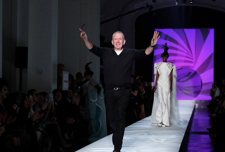 Designer Jean Paul Gaultier accepts applause at the end of his Haute Couture Spring-Summer 2018 fashion collection presented in Paris