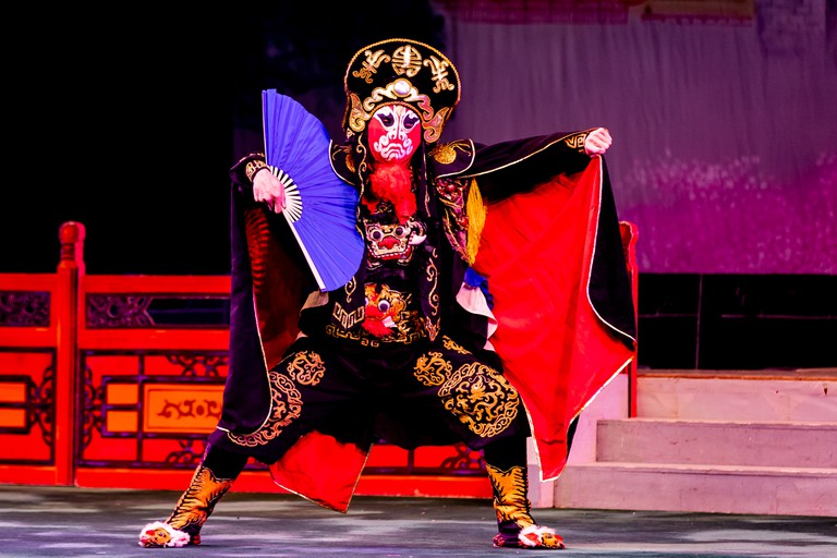 Artist performing Bian lian on stage