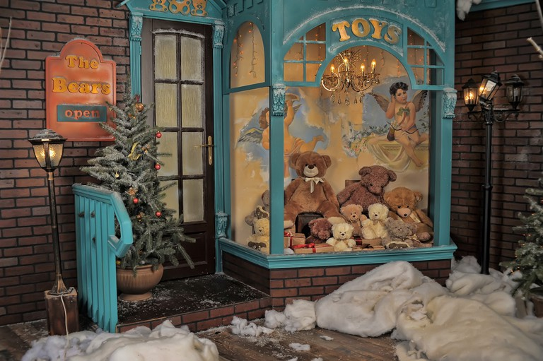 Vintage toy store on Christmas with bears in a shop window, Prague