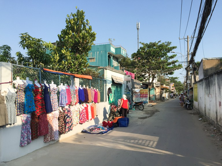People selling clothes on street in Thu Duc district, Saigon, Vietnam