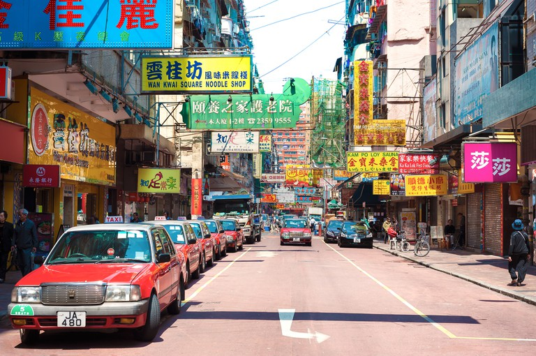 Taxis and shop signs in the Jordan area of Kowloon, Hong Kong.