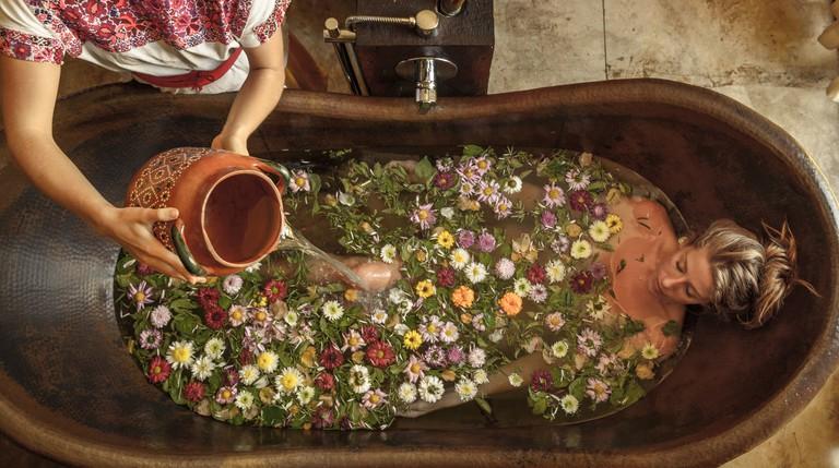 A customer takes a flowery bath at Mexico's Yäan Wellness Spa