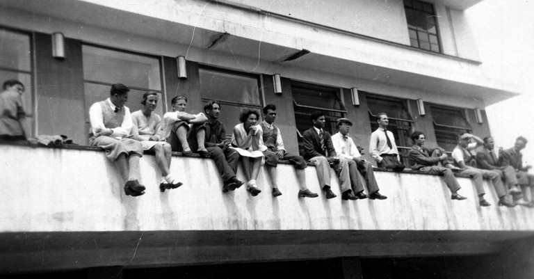 Bauhuas students on the balustrade of the canteen terrace, Dessau, c.1931
